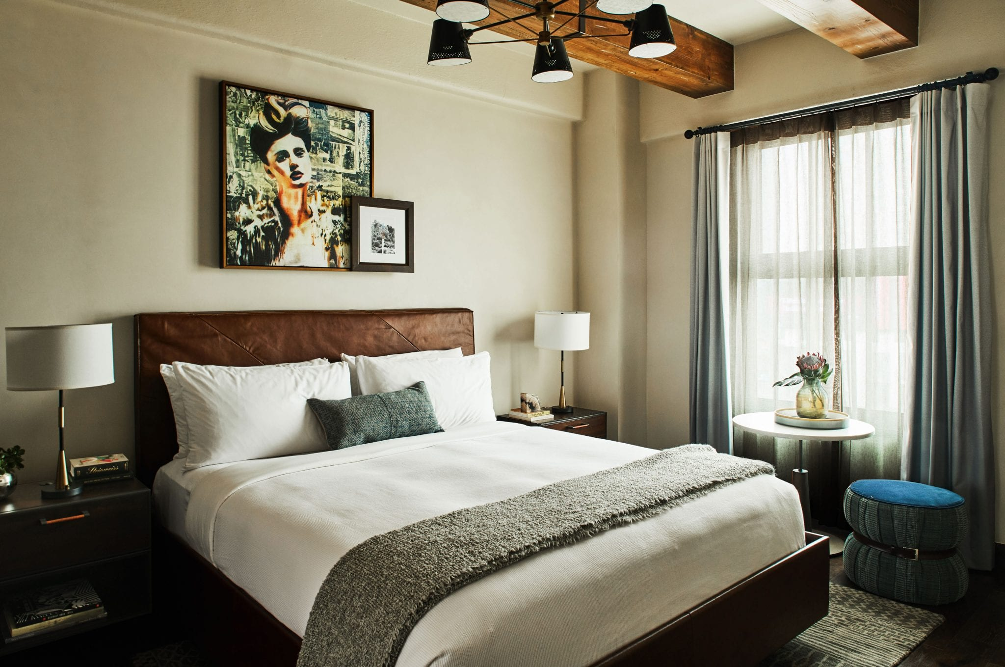 hotel room with bed, nightstands and large window