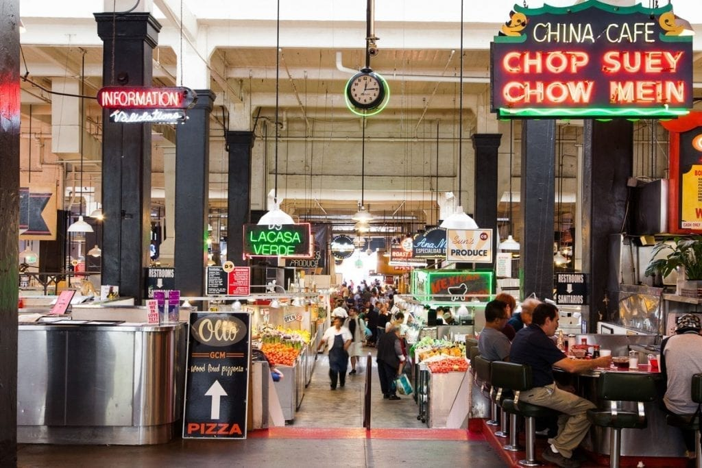 grand central market interior and people sitting at counter and walking